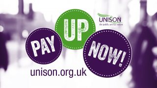 Pay up now written in three coins with unison website. images of people in background